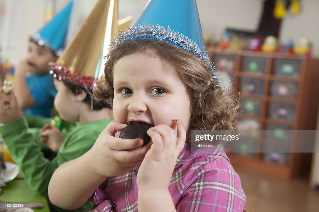 Fat Kid Eats Cake Stock Photos and Pictures Getty Images