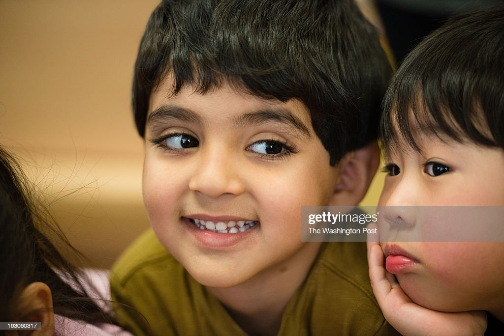 Preschoolers, Colin Lee, 3, left, and Arad Mehrabian, 4, watch a science experiment. At the St. Andrews Episcopal School in Potomac, MD, they use brain research to inform teaching and learning. The school has the only K-12 school center for teaching based on brain research in the country.