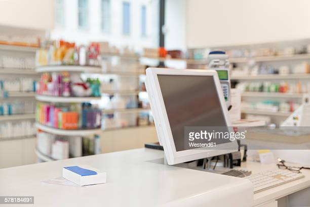 Prescription and drug lying on counter of a pharmacy