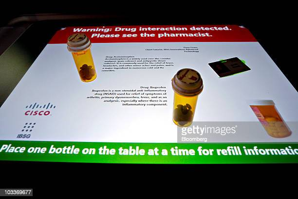 Prescription drug explanations and interactions are shown on an interactive pharmacy display developed by Cisco Systems Inc's Internet Business...