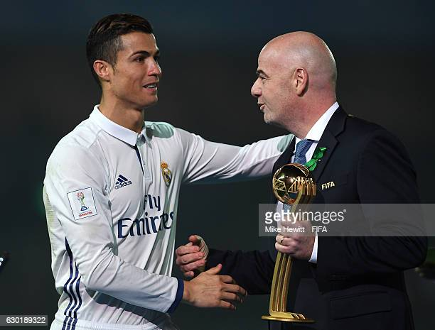FIFA presedent Gianni Infantino hands Cristiano Ronaldo of Real Madrid the Golden Boot trophy during the FIFA Club World Cup Final match between Real...