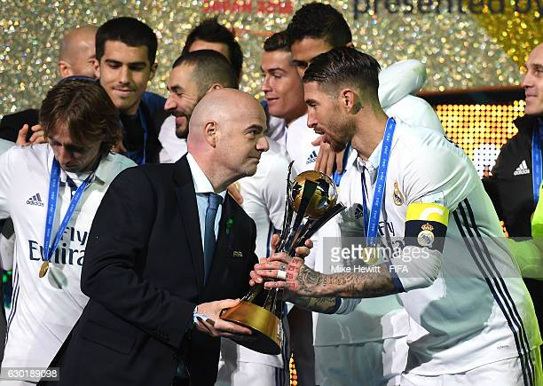 FIFA presedent Gianni Infantino hands Sergio Ramos of Real Madrid the winners trophy during the FIFA Club World Cup Final match between Real Madrid...