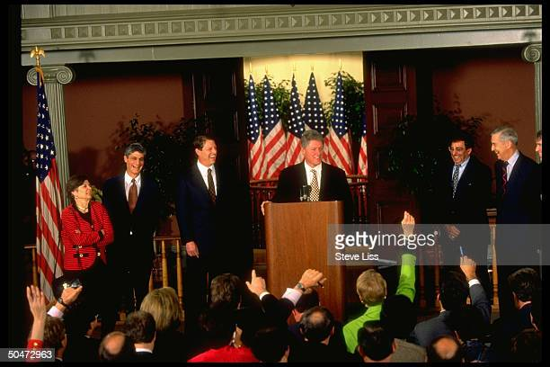 Preselect Bill Clinton flanked by economic appointees Altman Bentsen Panetta VPelect Gore Rubin Rivlin during announcement press conf