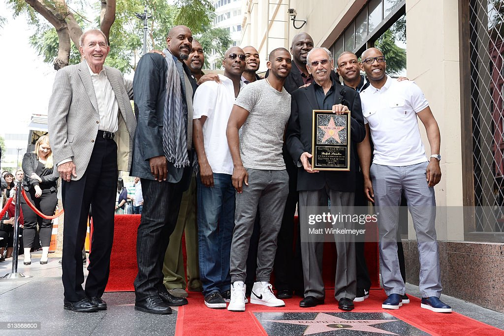 Present and former Los Angeles Clippers players including, Lamond Murray, Gary Grant, Chris Paul, Sam Cassell, Olden Polynice, Norm Nixon, Cuttino Mobley, and coach Doc Rivers, pose for a photo as sportscaster Ralph Lawler is honored with a Star on the Hollywood Walk of Fame on March 3, 2016 in Hollywood, California.