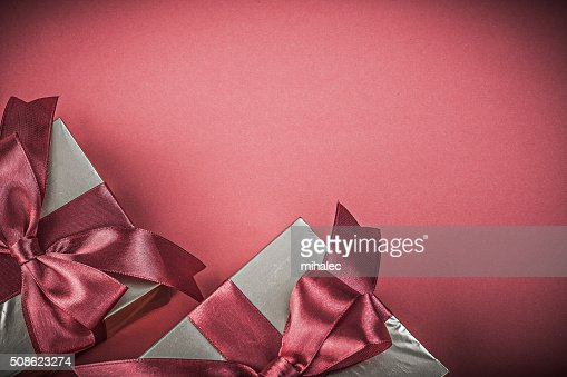 Present boxes on red background top view holidays concept : Stock Photo