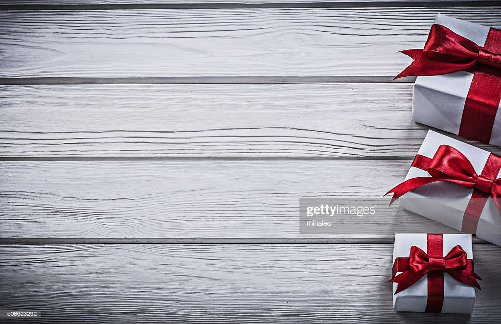 Present boxes on wooden board copy space holidays concept : Stock Photo