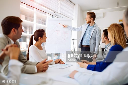 Presentation and collaboration by business people : Stock Photo