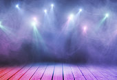 Abstract purple stage with smoke and spot lights. Presentation concept