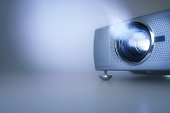 LCD video projector at business conference or lecture with copy space
