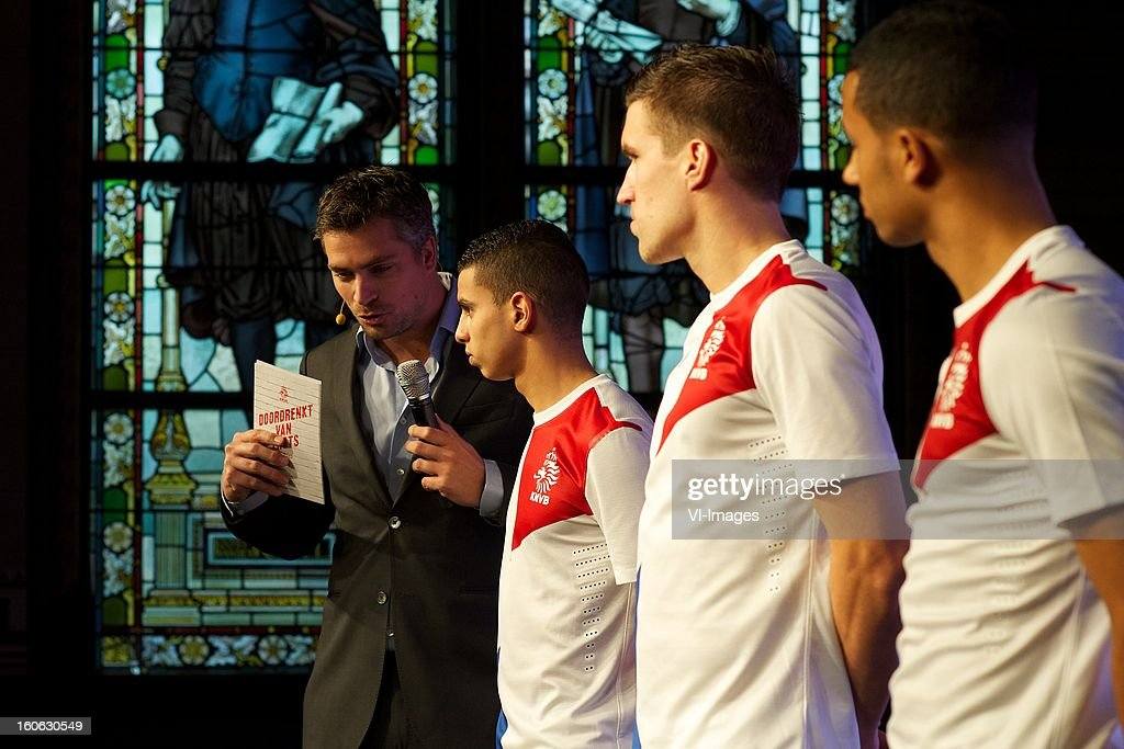 presentator Hidde van Warmendam, Adam Maher of AZ, Kevin Strootman of PSV, Ricardo van Rhijn of Ajax during the presentation of the new Netherlands National team kit on February 4, 2013 at Amsterdam, Netherlands.