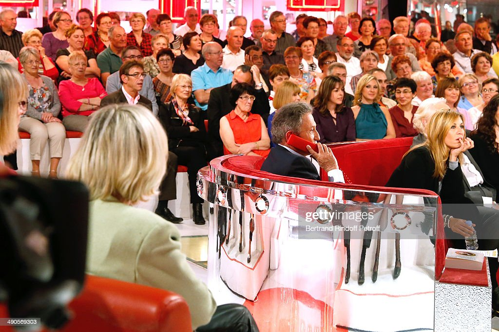 Presentator of the show Michel Drucker and main guest of the show actress mathilde Seigner attend the 'Vivement Dimanche' French TV show at Pavillon Gabriel on May 14, 2014 in Paris, France.