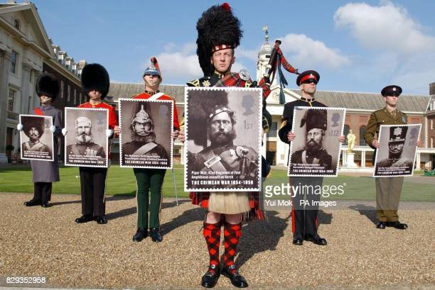 Presentday soldiers representing the same regiments of the six Crimean heroes featured on a new set of Royal Mail Crimean War stamps during a...