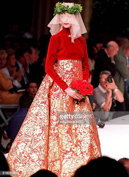 Presented at the end of the Pierre Balmain 1993/94 Fall/Winter high fashion collection 19 July 1993 by Oscar de la Renta the bride wears a red velvet...