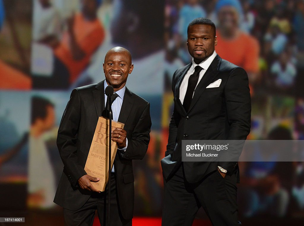 Presenter <a gi-track='captionPersonalityLinkClicked' href=/galleries/search?phrase=50+Cent+-+Rapper&family=editorial&specificpeople=215363 ng-click='$event.stopPropagation()'>50 Cent</a> and honoree Thulani Madondo of Kliptown Youth Program speak onstage during the CNN Heroes: An All Star Tribute at The Shrine Auditorium on December 2, 2012 in Los Angeles, California. 23046_006_MB_1286.JPG