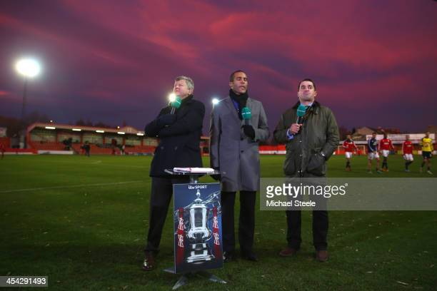 ITV presenter Adrian Chiles alongside Clarke Carlisle and Martin Allen during the FA Cup Second Round match between Tamworth and Bristol City at The...