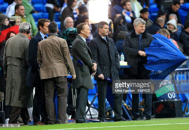 ITV presenter Adrian Chiles shakes the rain of his umbrella as he stands with pundits Roy Keane Lee Dixon and Gareth Southgate on the sidelines