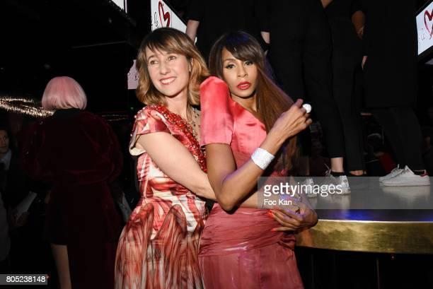 TV presenter Alexia Laroche Joubert dressed by On Aura Tout and Vu choreographer Mia Frye dressed by On Aura Tout Vu attend the 'Red Defile' Auction...