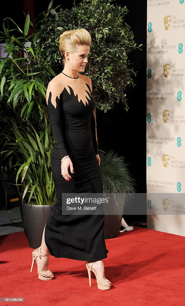 Presenter Alice Eve poses in the Press Room at the EE British Academy Film Awards at The Royal Opera House on February 10, 2013 in London, England.