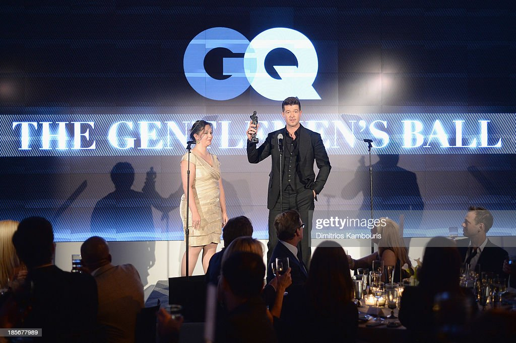 Presenter Allison Morris and Singer Robin Thicke speak onstage at the 2013 GQ Gentlemen's Ball presented by BMW i, Movado, and Nautica at IAC Building on October 23, 2013 in New York City.