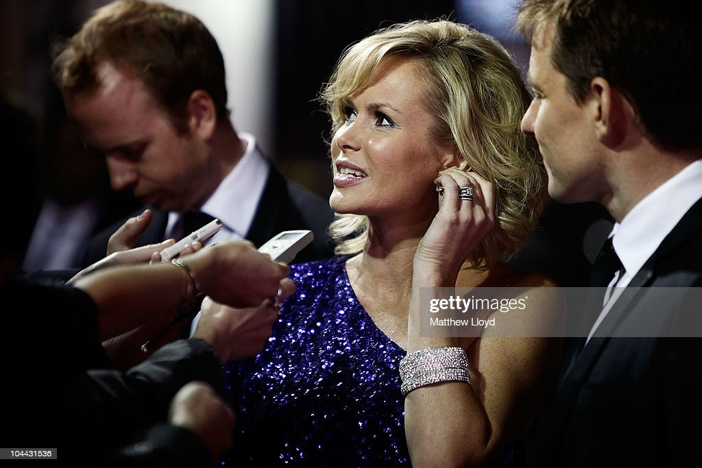 Presenter Amanda Holden talks to the media outside the British Olympic Ball at Grosvener House hotel on September 24, 2010 in London, England. Over 60 Olympic medallists joined an audience of over 1100 to raise funds for Team GB ahead of the London 2012 Olympic Games.