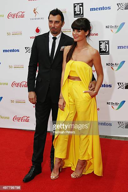 Presenter Amber Pebbles and husband Brooke HowardSmith pose for a photo on the red carpet at the Vodafone New Zealand Music Awards at Vector Arena on...