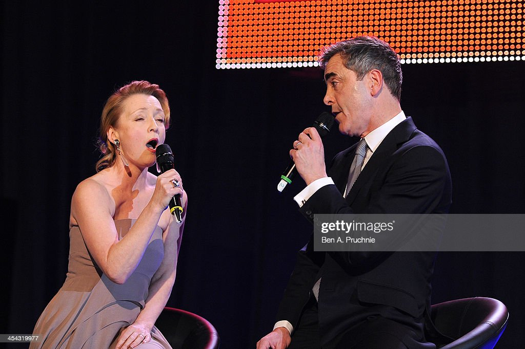 Presenter and actor James Nesbitt and actress Lesley Manville sing during the ceremony for the Moet British Independent Film Awards at Old Billingsgate Market on December 8, 2013 in London, England.
