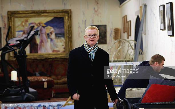 TV presenter and business entrepreneur Chris Evans prepares his wares for business at Camden Stables Market on November 26 2004 in London He is...