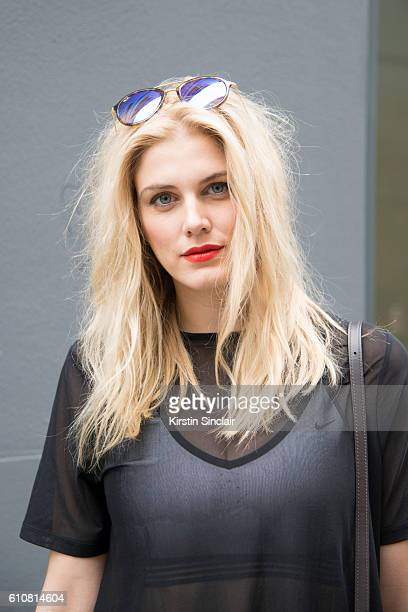 Presenter and DJ Ashley James wears a Nike bralette and and Asos top and RayBan sunglasses on day 5 of London Womens Fashion Week Spring/Summer 2016...