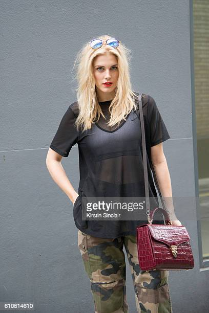 Presenter and DJ Ashley James wears a Nike bralette and and Asos top vintage trousers Aspinal of London bag and RayBan sunglasses on day 5 of London...