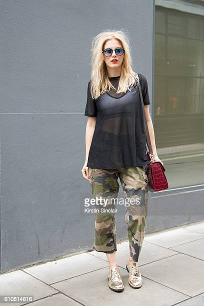 Presenter and DJ Ashley James wears a Nike bralette and and Asos top River Island shoes vintage trousers Aspinal of London bag and RayBan sunglasses...