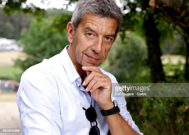 Presenter and doctor Michel Cymes poses during a portrait session in Paris France on