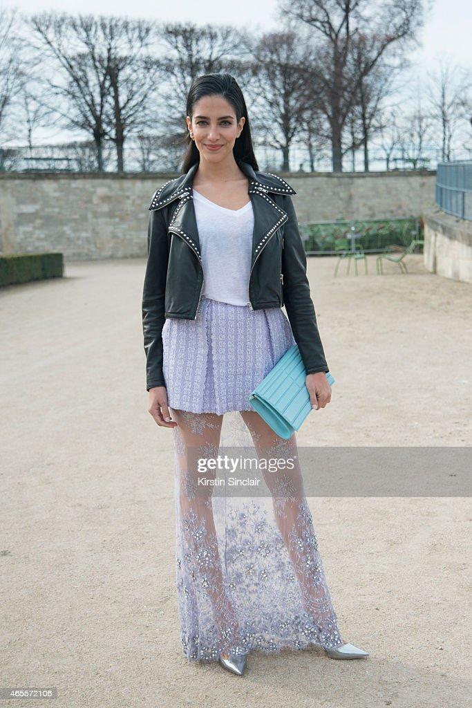 TV presenter and former Miss Australia Jessica Kahawaty wears Madiyah Al Sharqi jacket top and skirt Dior shoes Elie Saab bag on day 5 of Paris...