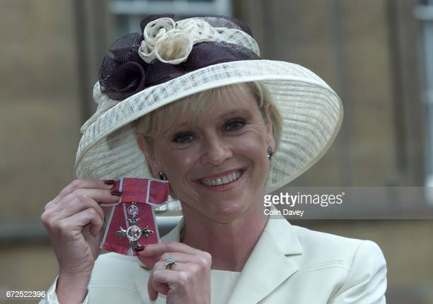 TV presenter and former tennis player Sue Barker holds her OBE after receiving it at Buckingham Palace London 22nd February 2000