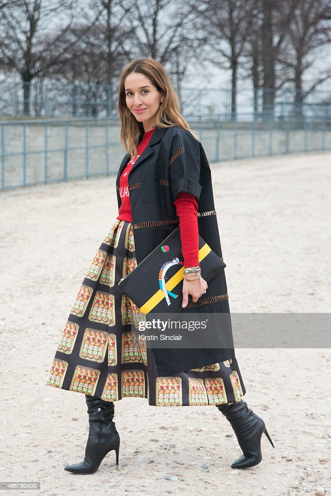 Presenter and Journalist Tiany Kiroloff wears a Veronica beard jacket Italian Theory skirt Miu Miu top and Halaby bag on day 8 of Paris Collections...
