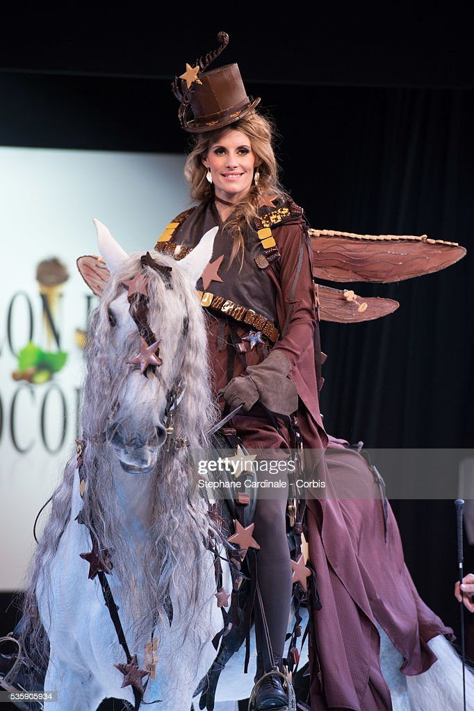 TV presenter and model Sophie Thalmann rides a horse on the runway and wears a chocolate dress made by Philippe Model and Frederic Cassel Fontainebleau during the Fashion Chocolate Show at Salon du Chocolat at Porte de Versailles, in Paris.