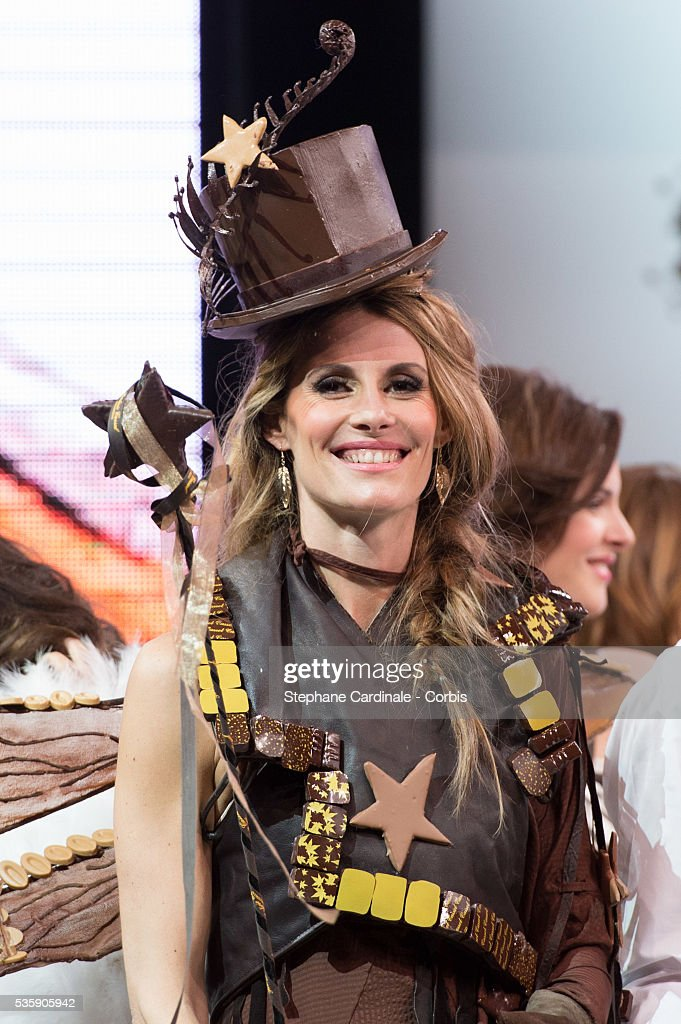 TV presenter and model Sophie Thalmann walks the runway and wears a chocolate dress made by Philippe Model and Frederic Cassel Fontainebleau during the Fashion Chocolate Show at Salon du Chocolat at Porte de Versailles, in Paris.