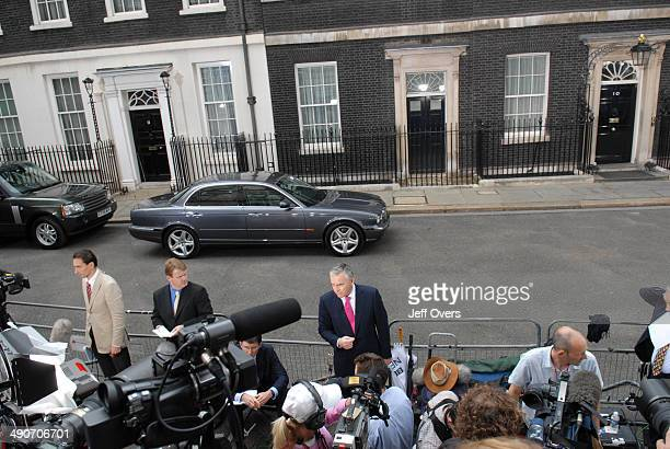 Presenter and newsreader Huw Edwards reports among the press throng outside 10 Downing Street on the day that Gordon Brown took over from Tony Blair...