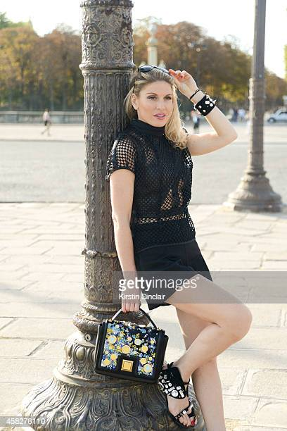 Presenter and prouducer Hofit Golan wears an Emanuel Ungaro bag and bracelet and a Guy Laroche top shorts and sunglasses on day 3 of Paris...