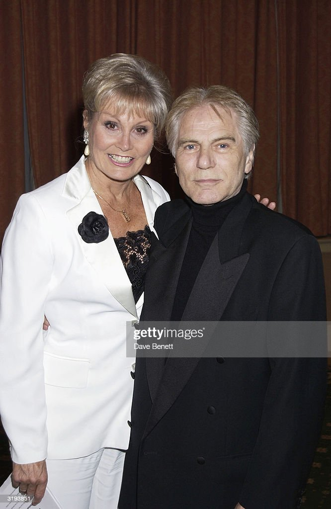 TV Presenter, Angela Rippon and Actor, Adam Faith attend The Variety Club Sports Awards held at The Grosvenor House Hotel on March 13th 2002, in London. (Photo by Dave Benett/Getty Images).