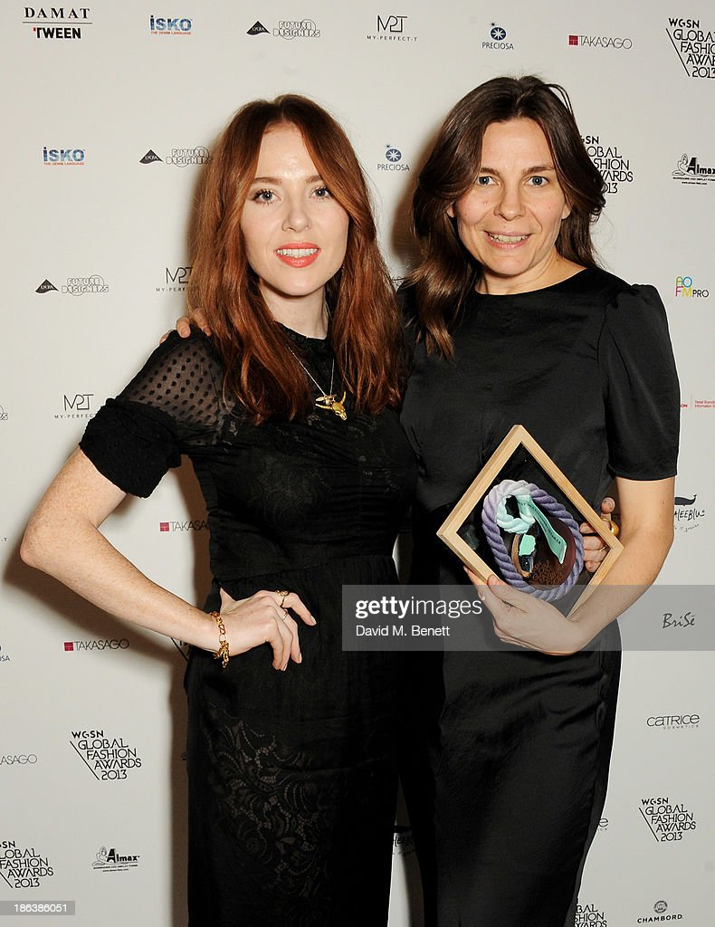 Presenter Angela Scanlon (L) and Kate Walmsley of Topshop, winner of the Best Multi-Channel Retailer award, pose backstage at The WGSN Global Fashion Awards at the Victoria & Albert Museum on October 30, 2013 in London, England.