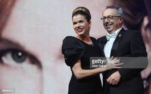 Presenter Anke Engelke and Festival director Dieter Kosslick attend the Opening Ceremony of the 60th Berlin International Film Festival at the...