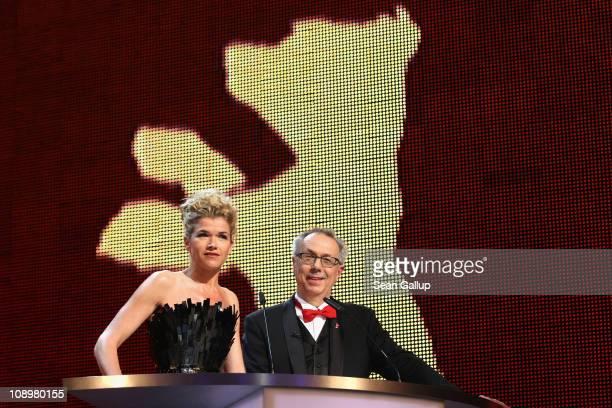 Presenter Anke Engelke and festival director Dieter Kosslick speak during the grand opening ceremony during the opening day of the 61st Berlin...
