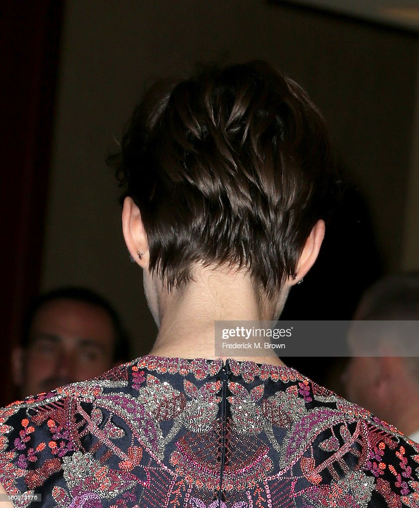 Presenter Anne Hathaway (fashion detail) poses in the press room during the 65th Annual Directors Guild Of America Awards at Ray Dolby Ballroom at Hollywood & Highland on February 2, 2013 in Los Angeles, California.