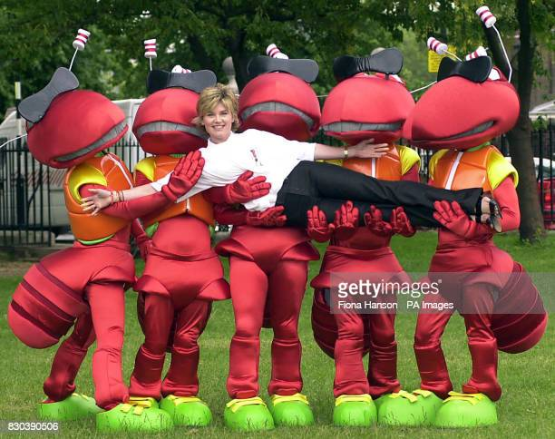TV Presenter Anthea Turner is held up by some cartoon ants from the online shopping service wwwLetsBuyItcom at the Chelsea Flower Show in London