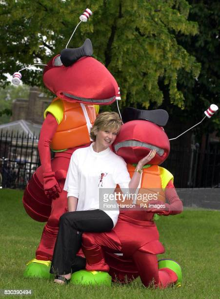 TV Presenter Anthea Turner with a pair of cartoon ants from the online shopping service wwwLetsBuyItcom at the Chelsea Flower Show in London