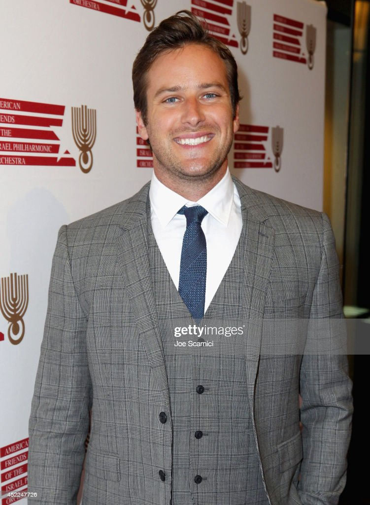 Presenter <a gi-track='captionPersonalityLinkClicked' href=/galleries/search?phrase=Armie+Hammer&family=editorial&specificpeople=5313113 ng-click='$event.stopPropagation()'>Armie Hammer</a> attends American Friends Of The Israel Philharmonic Orchestra Benefit Honoring Hans Zimmer at Wallis Annenberg Center for the Performing Arts on July 16, 2014 in Beverly Hills, California.