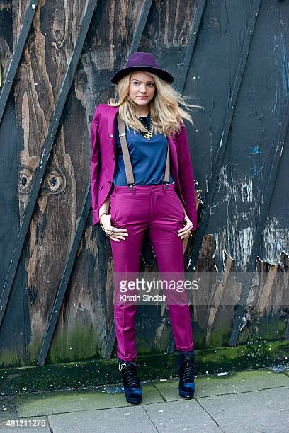 MTV presenter Becca Dudley wears a Top Man suit shirt and braces Top Shop shoes and a Vintage Hat day 1 of London Mens Fashion Week Autumn/Winter...