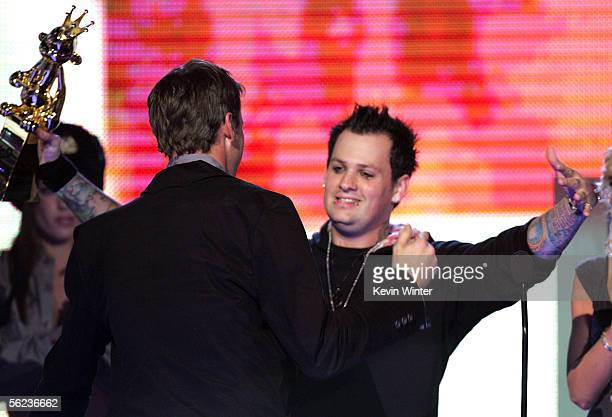 Presenter Benji Madden presents Best Individual Sports Game Award to skateboarder Tony Hawk onstage at the Spike TV 'Video Game Awards 2005' at the...
