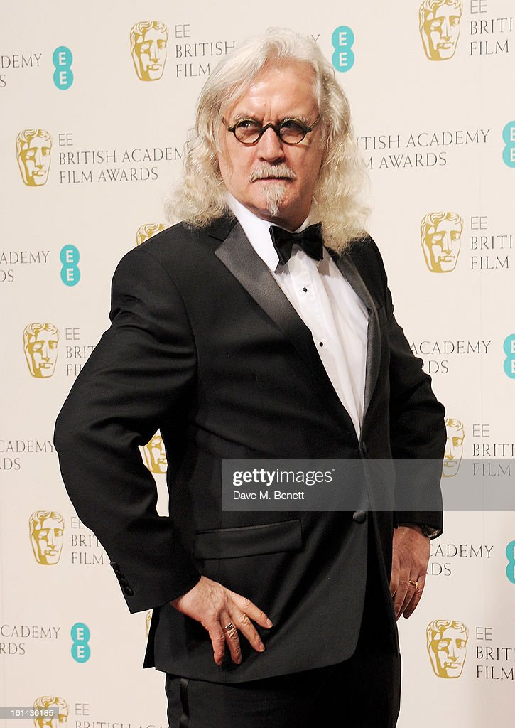 Presenter <a gi-track='captionPersonalityLinkClicked' href=/galleries/search?phrase=Billy+Connolly&family=editorial&specificpeople=208248 ng-click='$event.stopPropagation()'>Billy Connolly</a> poses in the Press Room at the EE British Academy Film Awards at The Royal Opera House on February 10, 2013 in London, England.