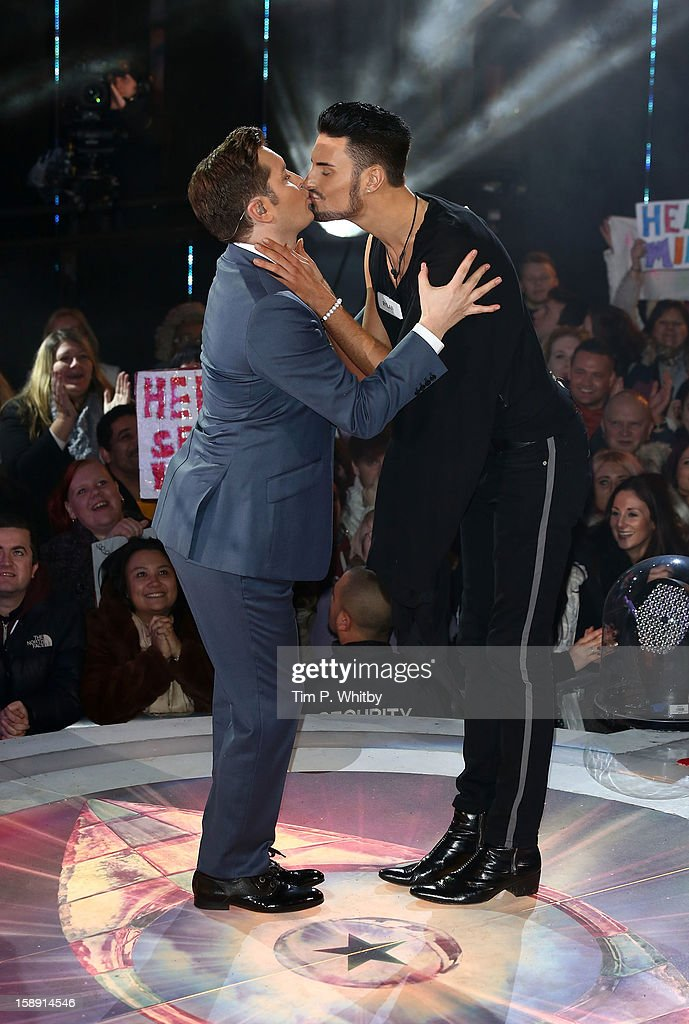 Presenter Brian Dowling kisses Rylan Clark before he enters the Celebrity Big Brother House at Elstree Studios on January 3, 2013 in Borehamwood, England.